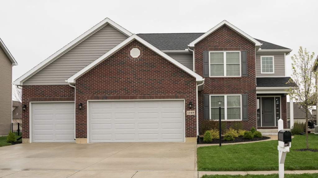 Arlington model with brick and dutchlap vinyl siding built in Edgewater (Troy)