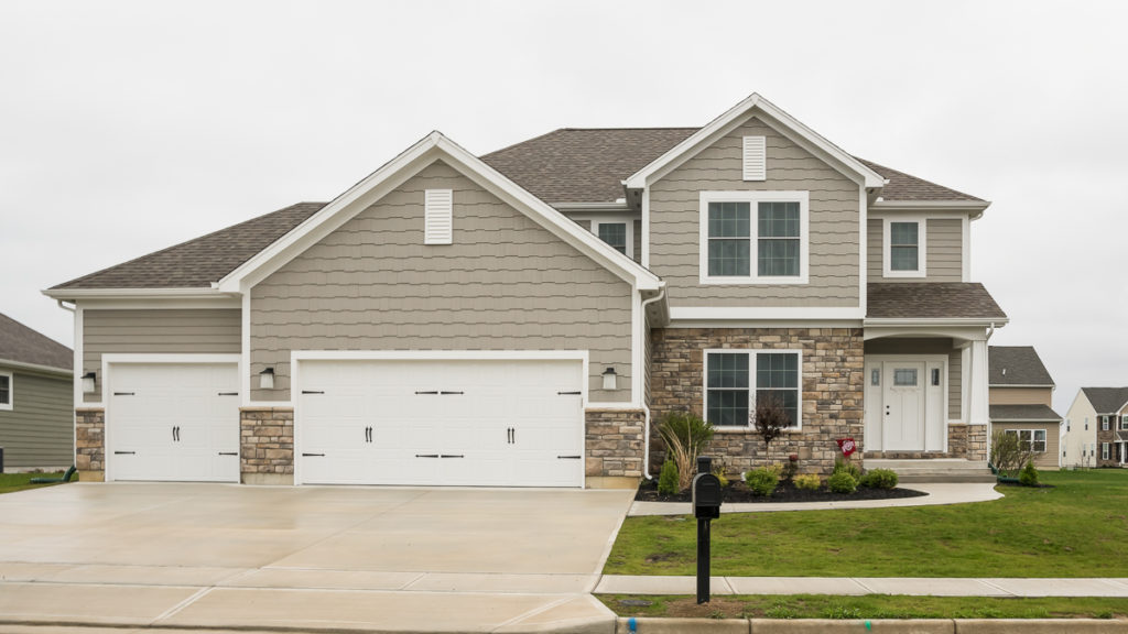 Arlington model with Casa Di Sassi Salerno Limestone and LP Smart siding and shakes in SW7642 built in the Meadows of Stonebridge