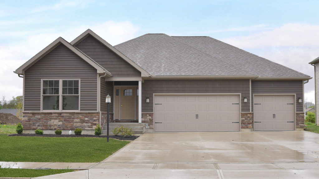 """Avondale model with Torino Weather Ledge stone, and Espresso double 4.5"""" dutchlap vinyl siding built in Edgewater (Troy)"""