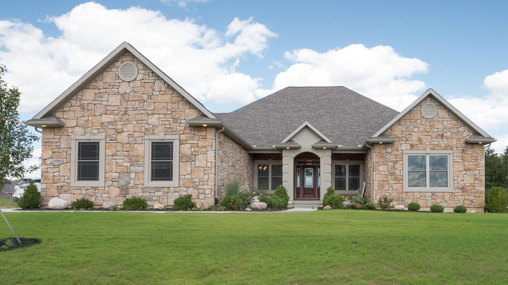 Barrington model with Old World Dorato stone, Olde Tuscany Queen brick and dryvit built in Halifax Estates (Troy)