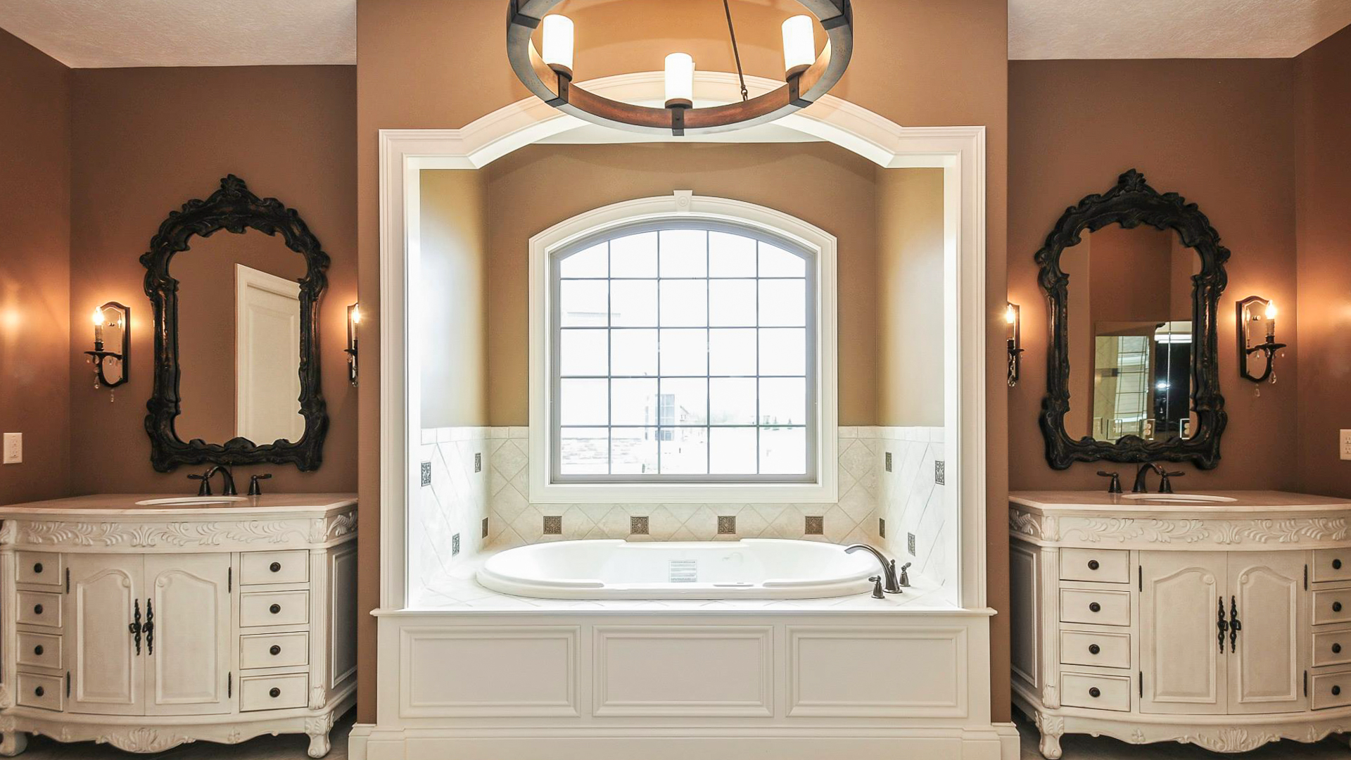 Custom master bathroom with furniture grade vanities and jetted tub