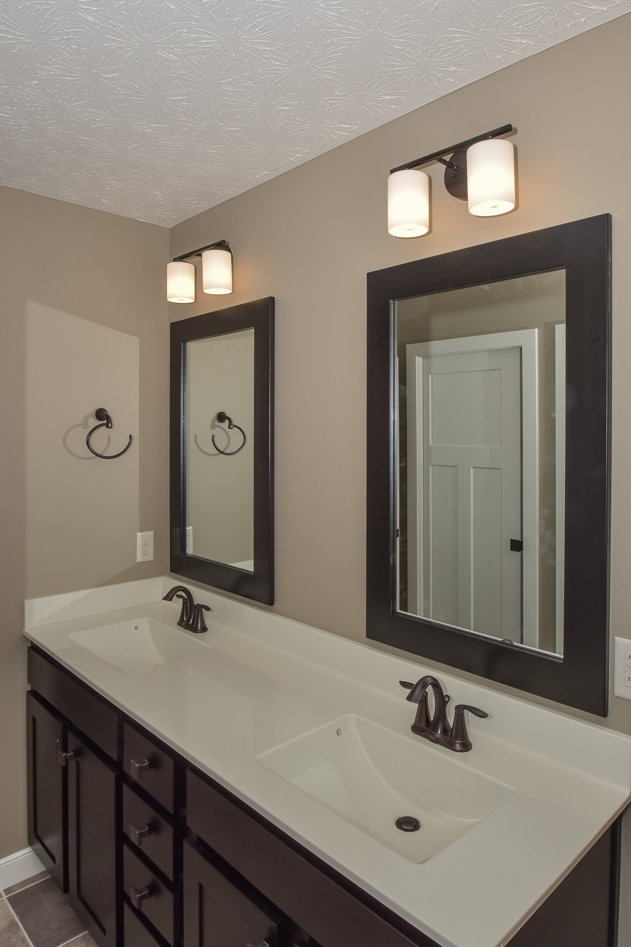 Norwich Double Espresso vanity, one-pc cultured marble top in biscuit with wave sink and Eva ORB fixture, Replay light fixture