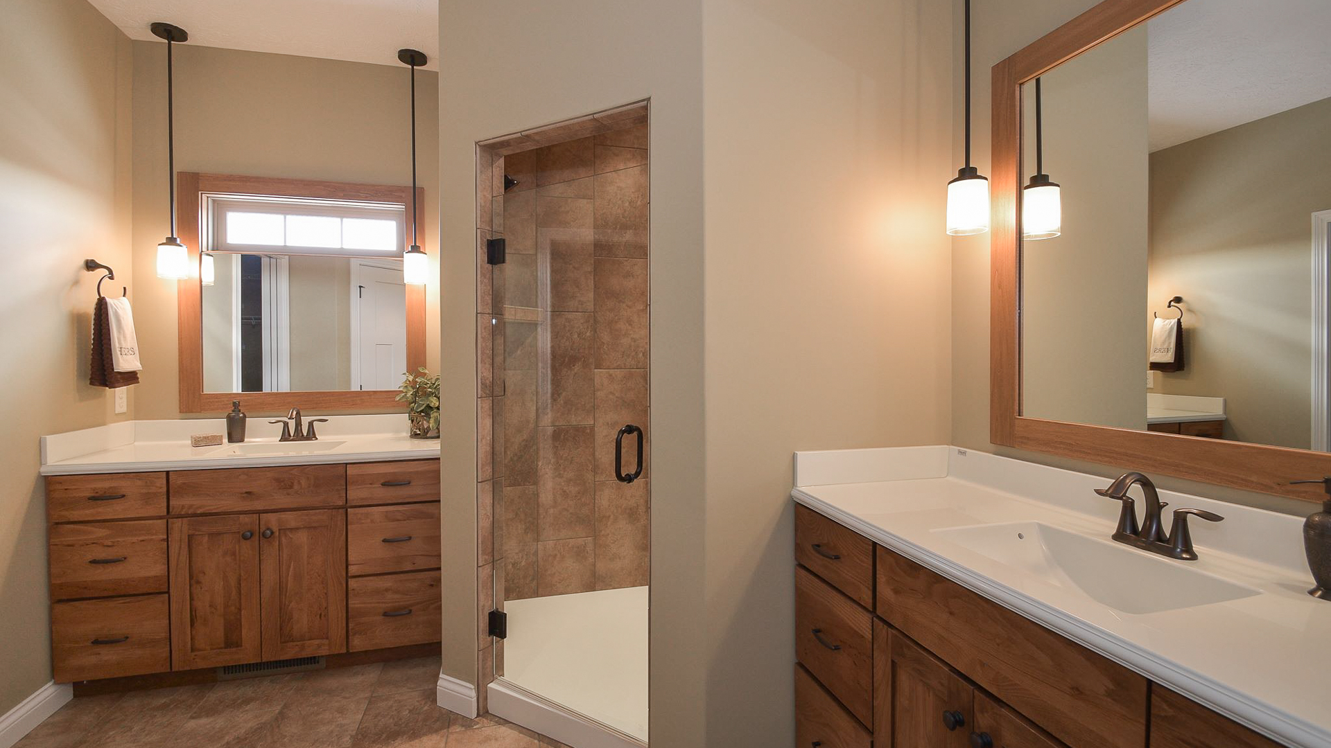 Corner shower with ceramic tile, Alexa, cultured marble tops and Eva ORB fixtures