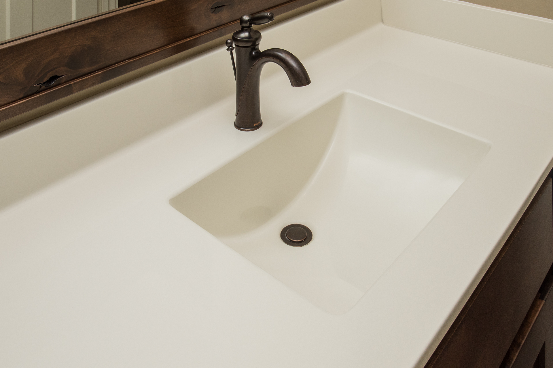 Cultured marble top with wave sink in #43 biscuit color, Moen Brantford oil rubbed bronze faucet