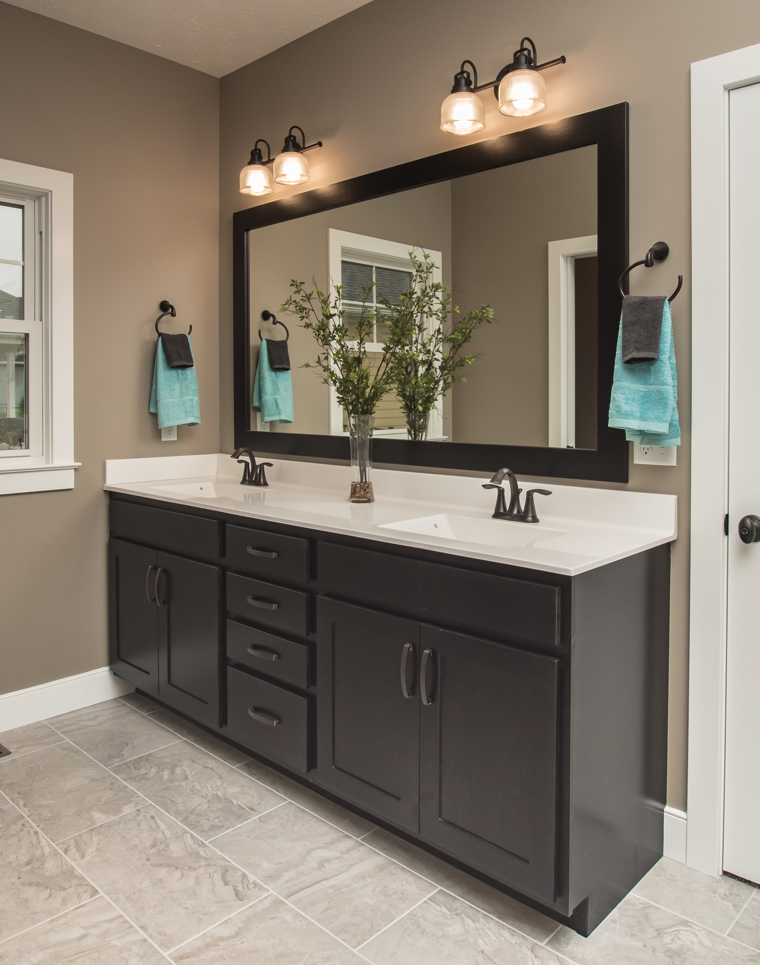 Maple Norwich in double espresso cabinets, one-piece cultured marble  #05 solid white wave sink, Moen Eva oil rubbed bronze faucets