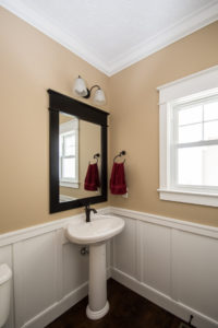Mansfield Waverly 340 pedestal with Moen Eva single-handle 6400 in oil rubbed bronze, wainscot detail on walls