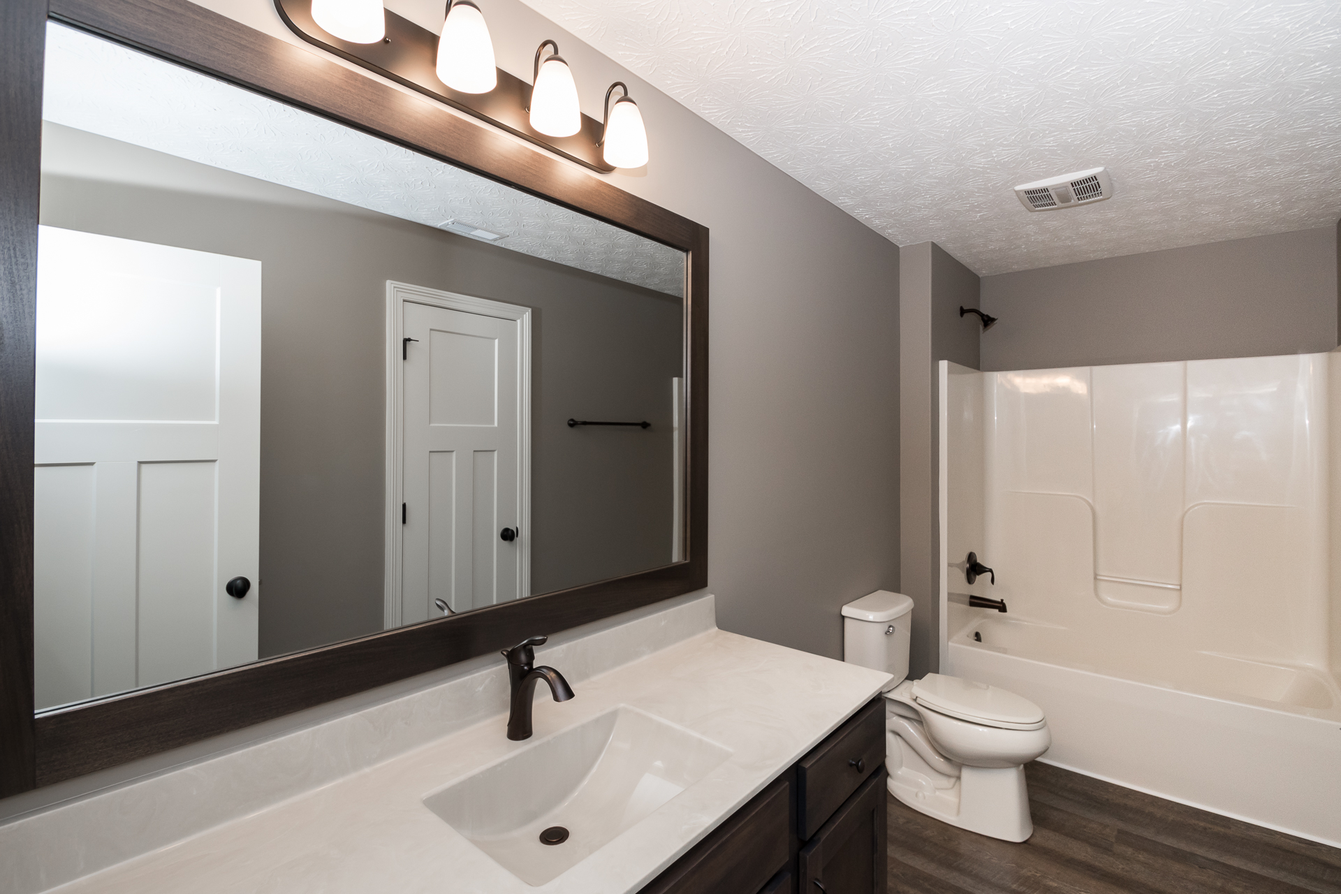 Cabinets: Camden Rustic Birch Stone Tops: one-piece cultured marble, #95 white on sandbar, wave bowl, Moen Eva 6400 oil rubbed bronze faucet