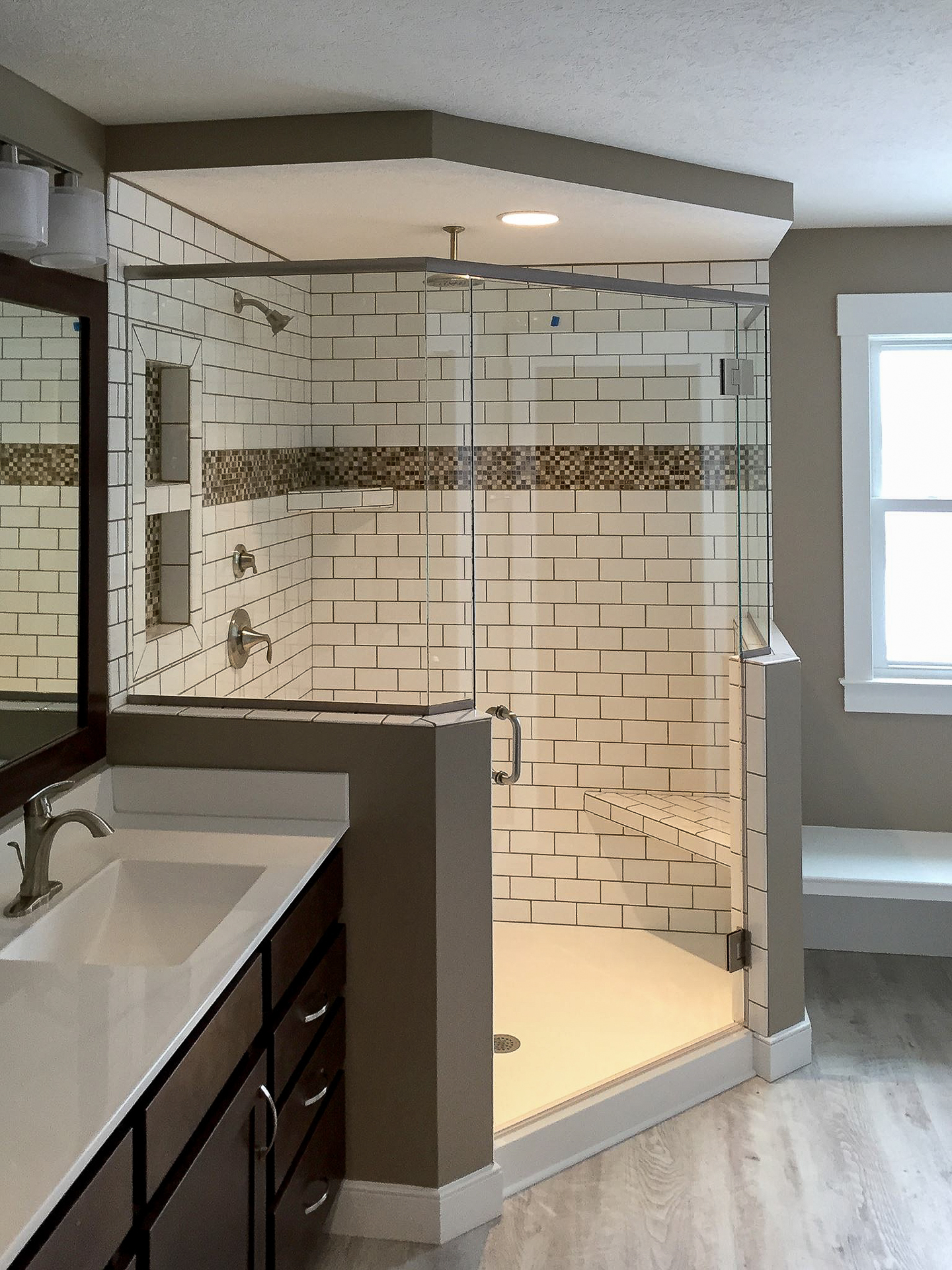 Corner shower with subway ceramic tile, recessed box, brushed nickel Eva fixture