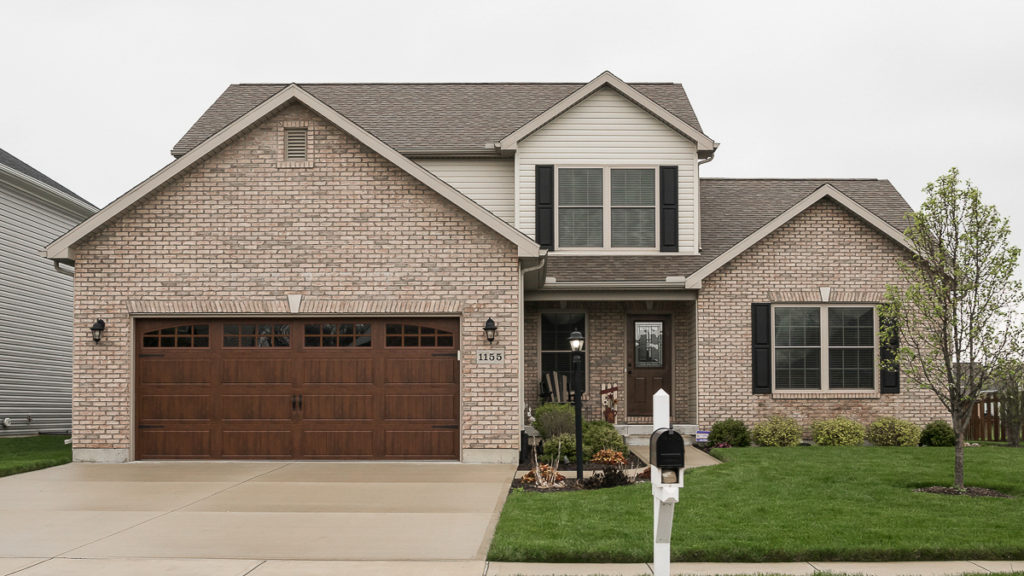 Belmont model with brick and vinyl siding built in Edgewater (Troy)