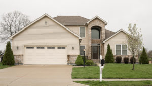 Belmont model with vinyl siding and limestone built in Edgewater