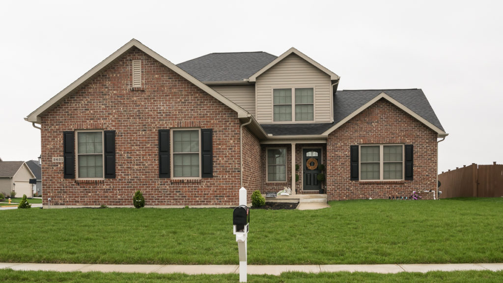 """Belmont model with Statesville Rustic Heritage brick and double 5"""" clay vinyl siding built in Edgewater (Troy)"""