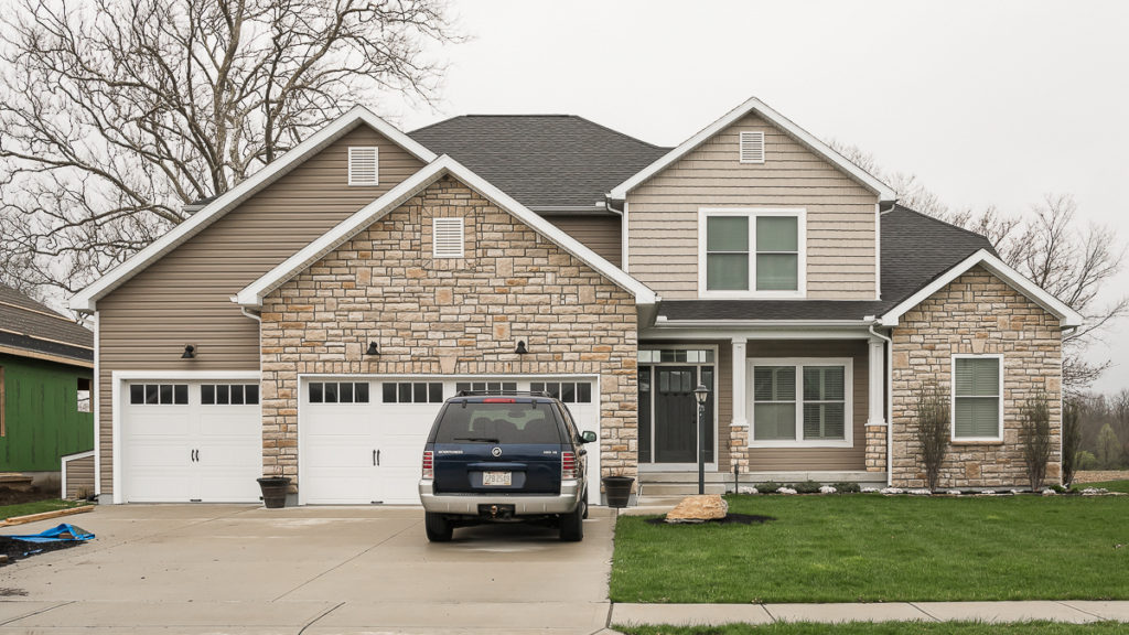 Belmont model with limestone siding and vinyl siding built in Edgewater (Troy)
