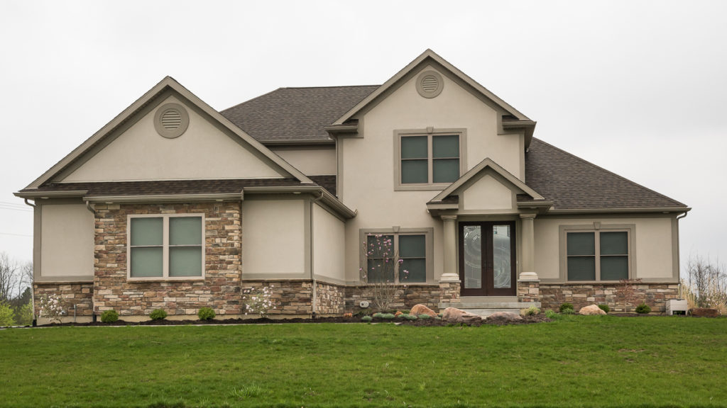 Modified Belmont with Dryvit and a mix of Torino and Natural Blend Weather Ledge stone built in Rosewood Creek (Troy)
