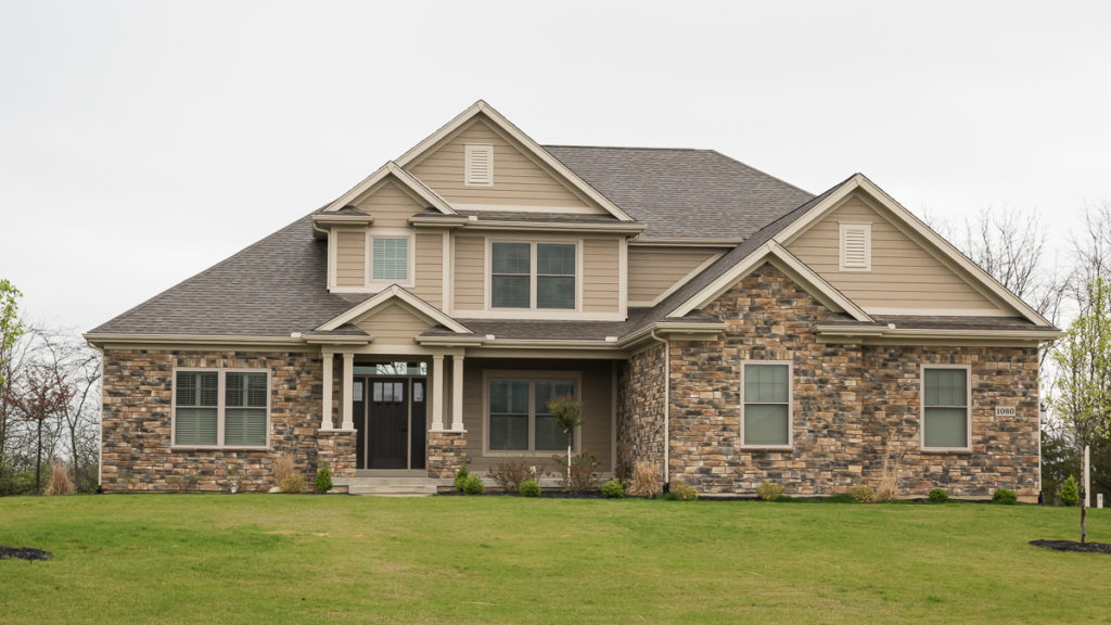Berkshire 2 story model with Sienna Weather Ledge stone, LP Smart siding in SW7535 built in Halifax Estates (Troy)