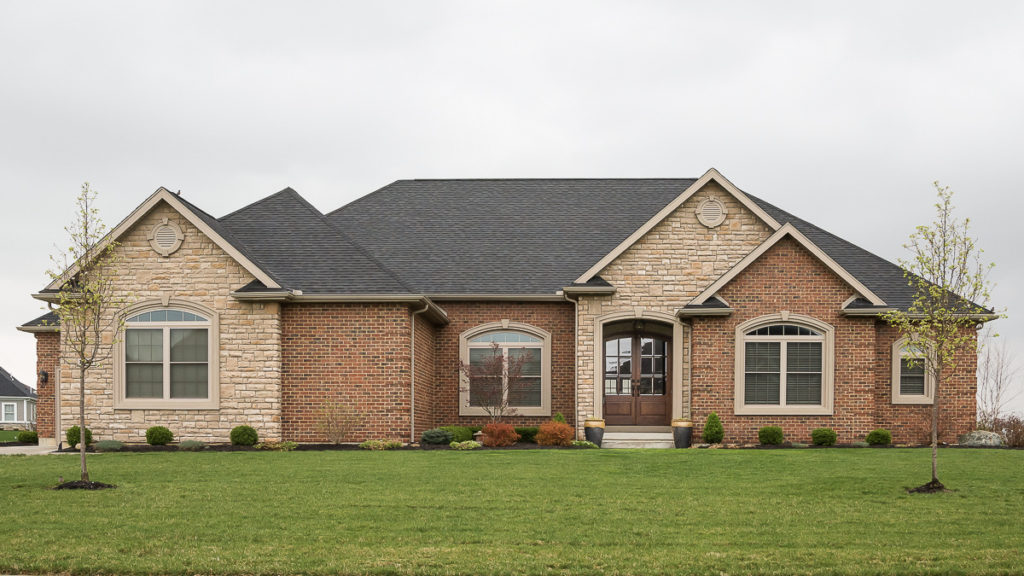 Custom built ranch with brick and stone built in Rosewood Creek (Troy)