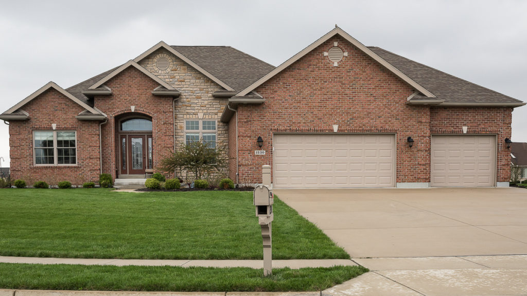 Custom built ranch with stone and brick built in Rosewood Creek (Troy)
