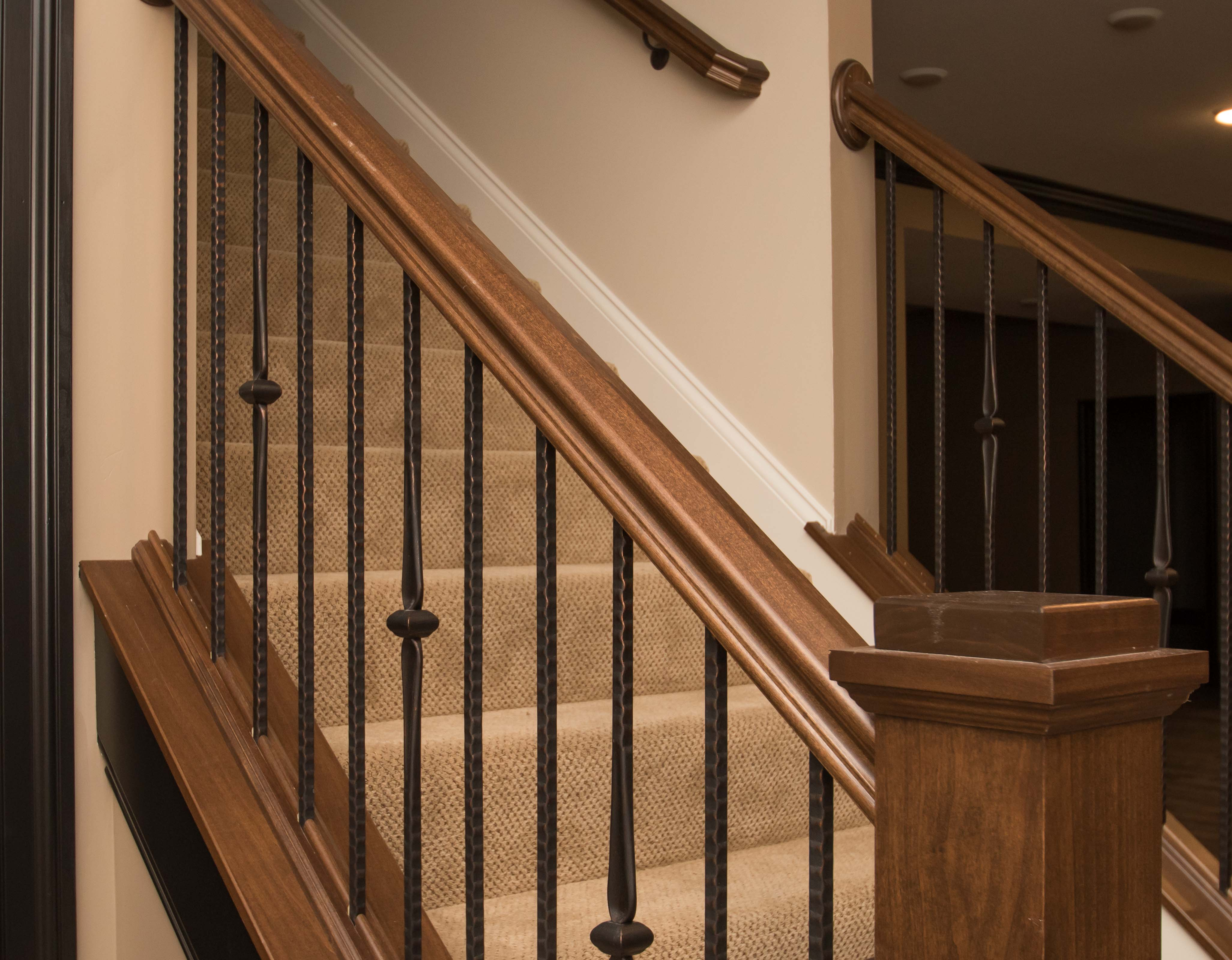Stained handrail and box newels with camelot iron ballusters #14344, #14344, #14044 pattern