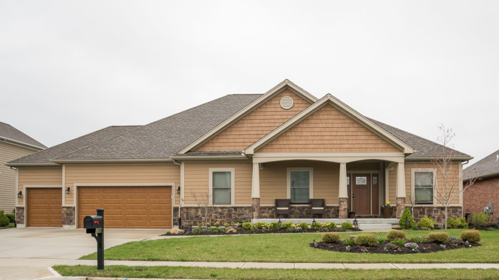 Edgebrook model with stone and painted LP Smart siding and shakes built in the Meadows of Stonebridge (Troy)