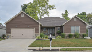 Excalibur model with vinyl siding and stone built in Edgewater