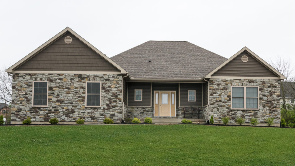 """Excalibur model with Steinhaus Tuscan Ridge stone and Espresso double 4.5"""" dutchlap siding and shakes built in Stonybrook (Troy)"""