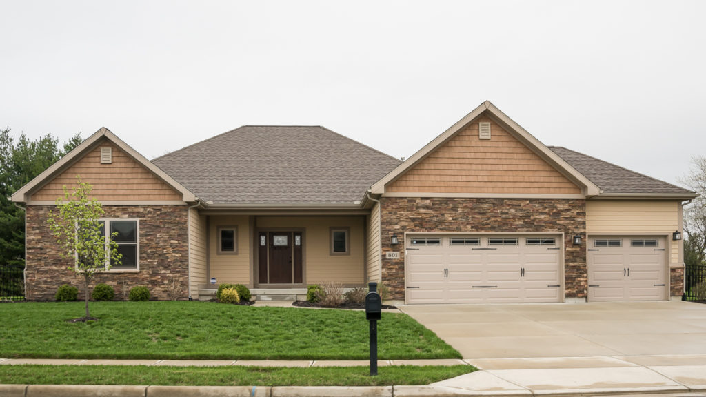 Excalibur with painted LP Smart siding and shakes, and stone built in the Meadows of Stonebridge (Troy)
