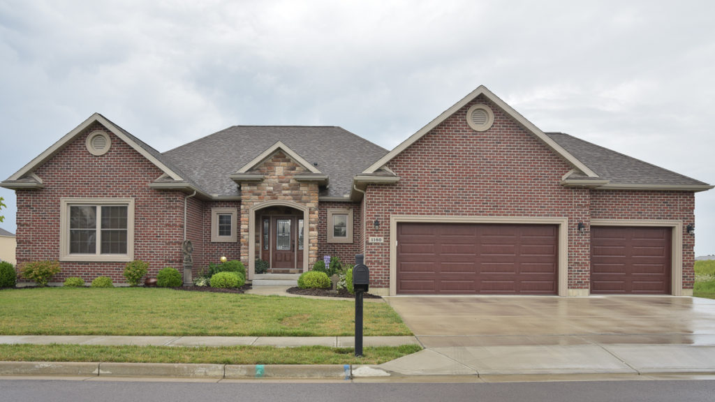 Excalibur model with brick and Autumn Blend Limestone built in the Meadows of Stonebridge (Troy)