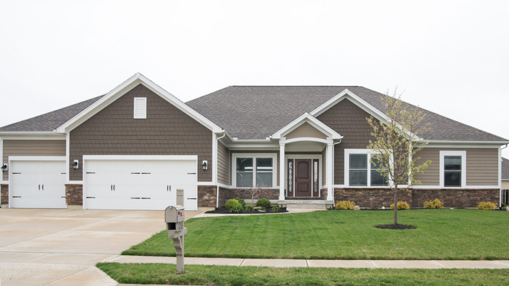 Custom built ranch with painted LP Smart siding and shakes and stone built in Rosewood Creek (Troy)