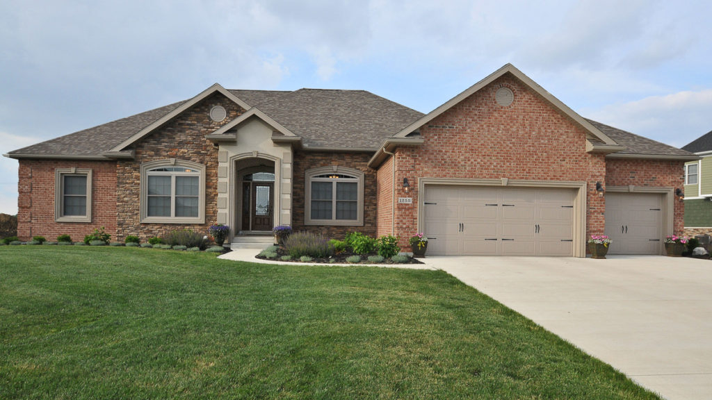 Glendale Model home with brick, stone and dryvit stoop built in Rosewood Creek