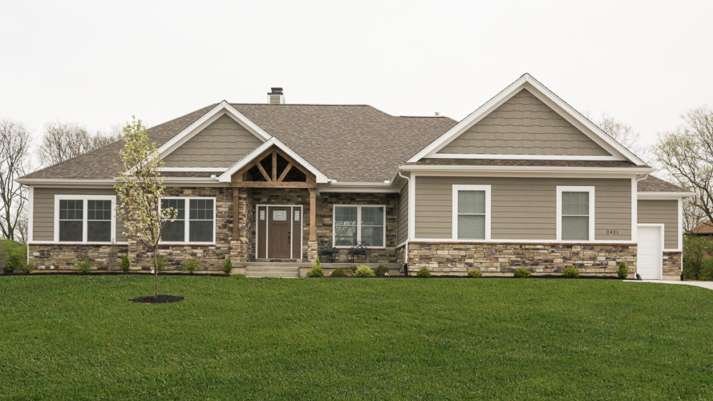 Glendale Model modified with Sagewood Weather Ledge stone, painted LP Smart siding & shakes in SW7046 built  in Stonybrook