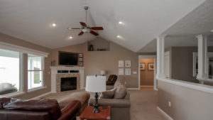 Great room in Talladega model features corner fireplace and cathedral ceiling