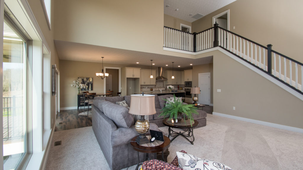2 story open great room of Berkshire model leads into kitchen