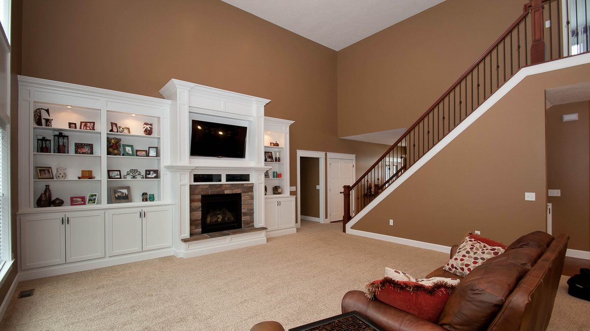 2 story great room of Belmont model features fireplace and built ins