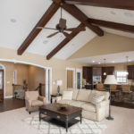 Great room of Excalibur model with cathedral ceilings and wood beams