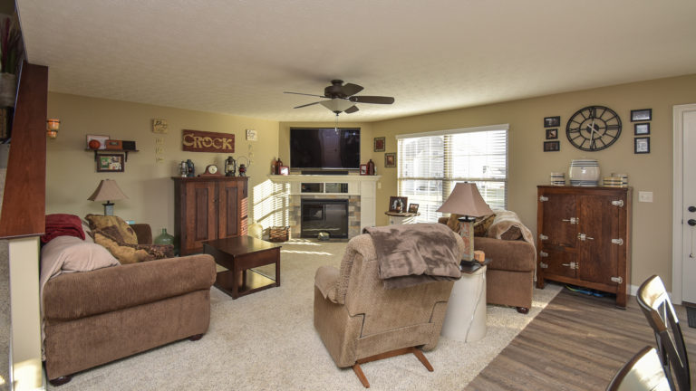 Great room of Saratoga model with corner fireplace