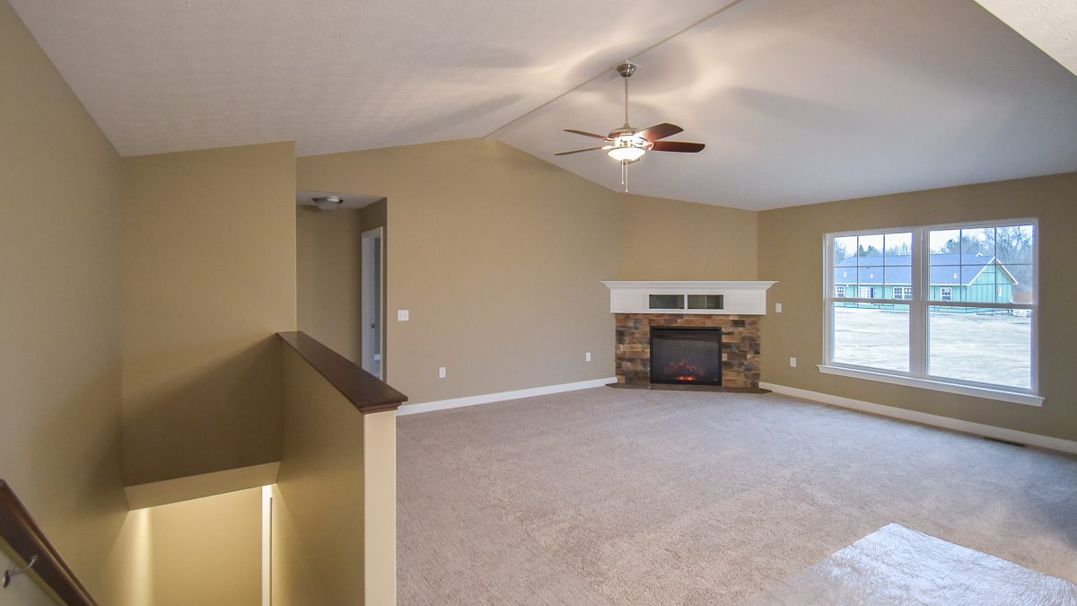 Great room of Avondale model with corner fireplace