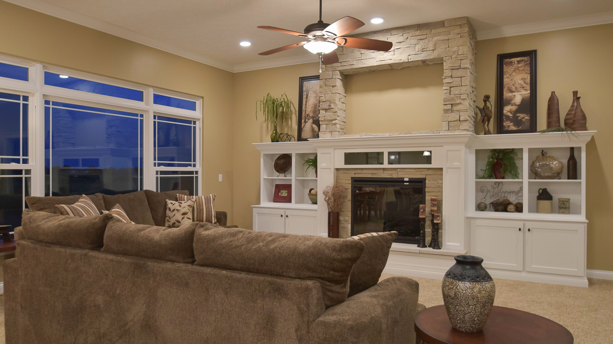 Great room of Allison model features 11' ceiling, centered fireplace with built ins