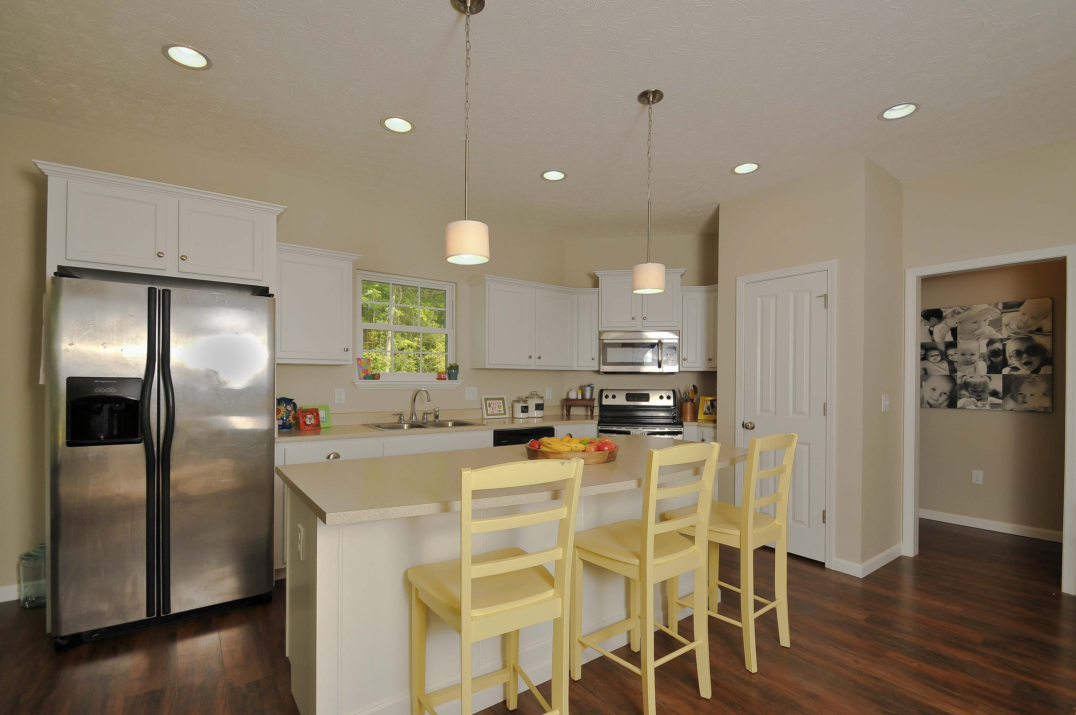 Kitchen of Talladega features white cabinets, and laminate countertops