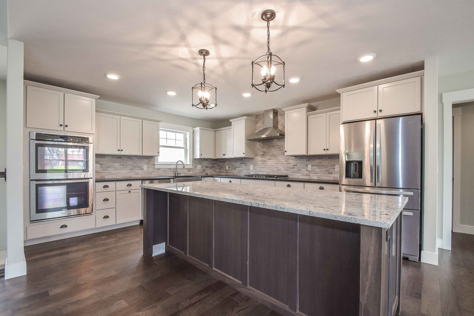 Echelon Rossiter in Latte (painted) cabinets with Storm in island, Engineered hardwood flooring Mohawk American Vintique Weathered Hickory WEC92-89