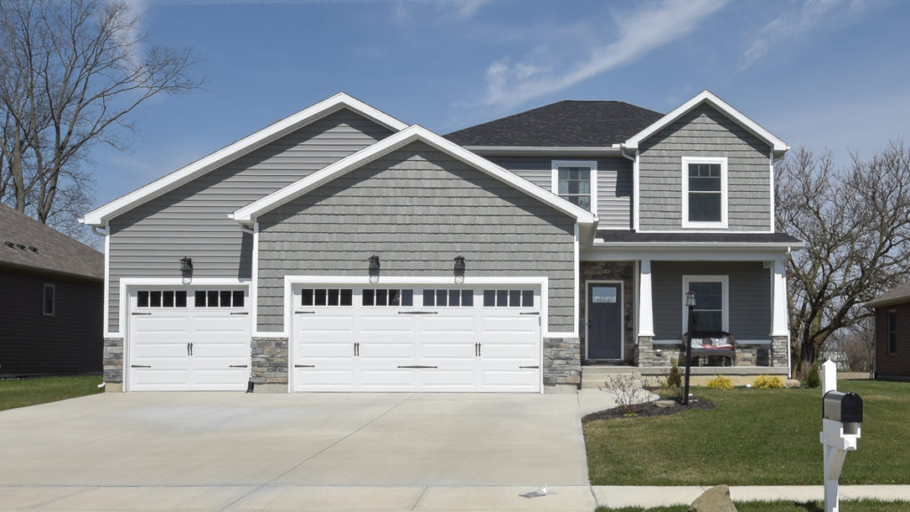 Saratoga Model with stone, vinyl siding and shakes built in Edgewater
