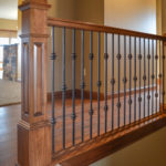 Stained newel posts & railings, and knuckles-Single/Double/single iron balusters