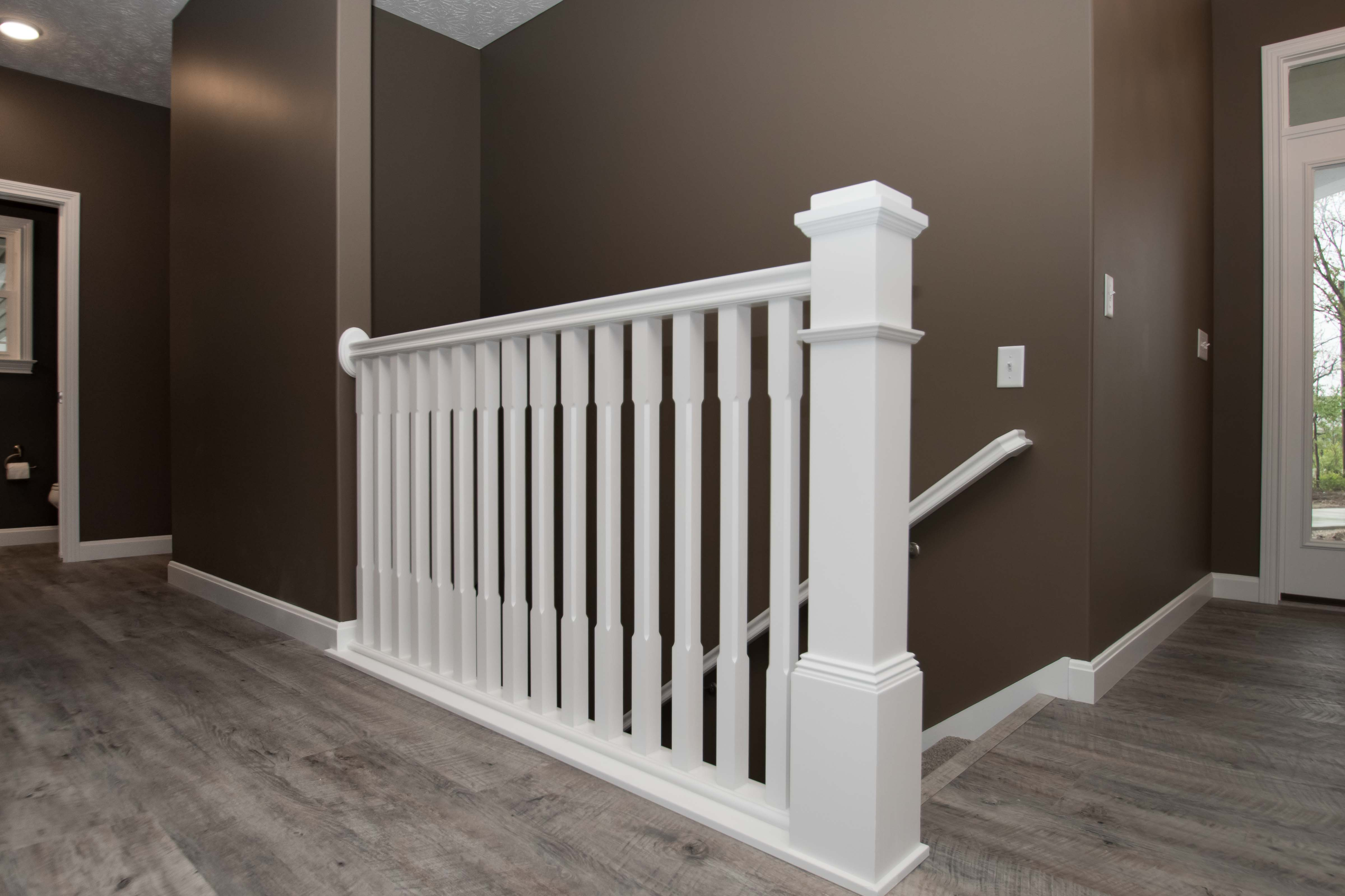 Painted plain box newel posts. Painted chamfered-square spindles.