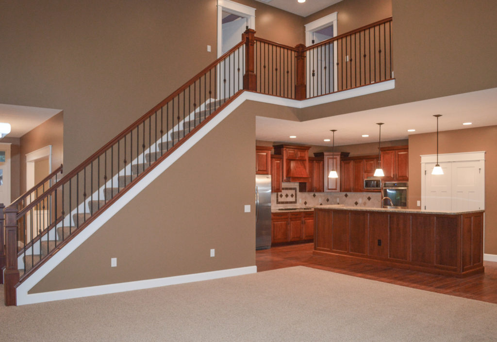 Stained newel posts & railings, painted skirtboards and knuckles-plain/plain/single iron balusters