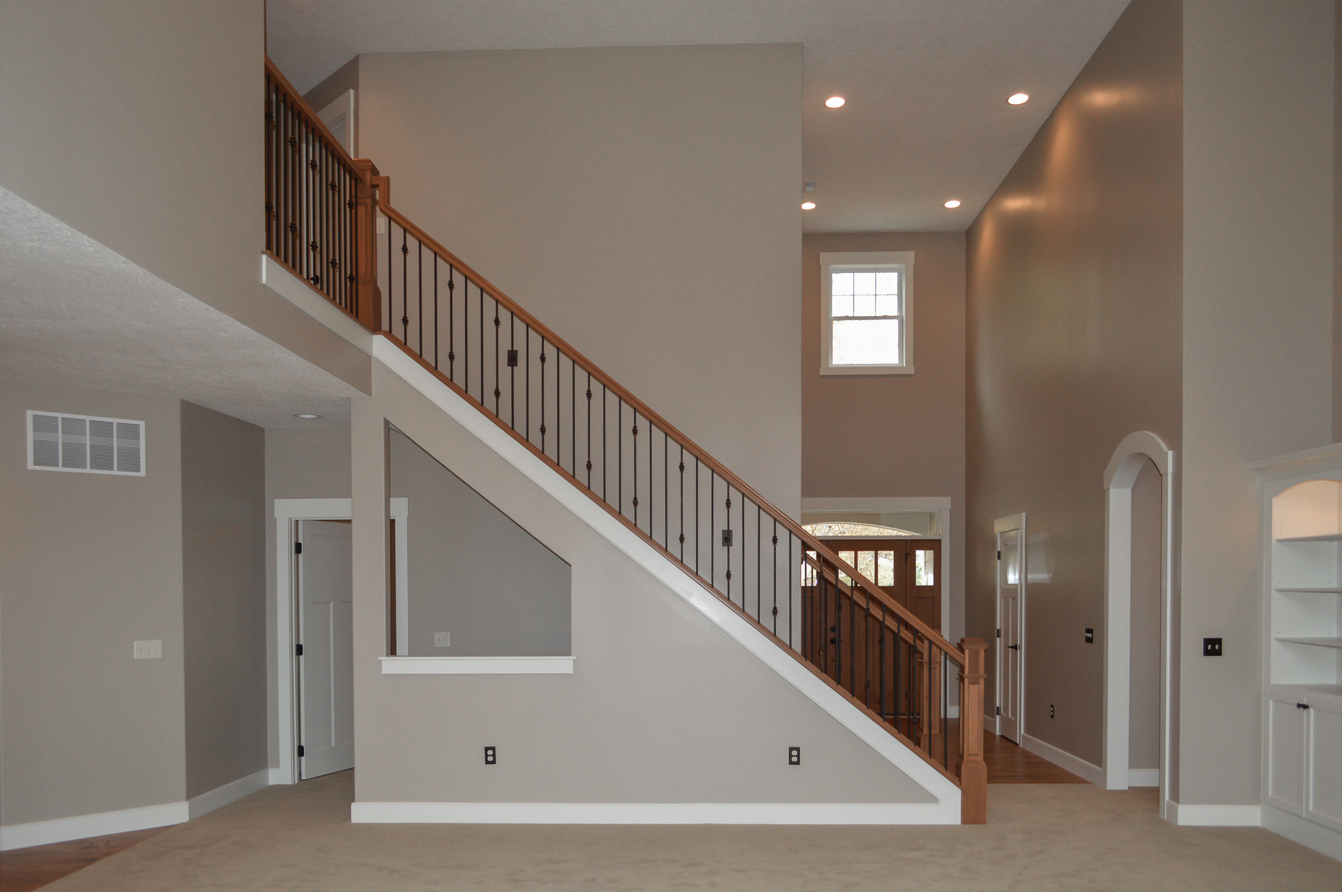 Stained newel posts & railings, and knuckles-double/plain/plain/double iron balusters