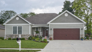 Talladega model with vinyl siding and shakes and stone built in Edgewater