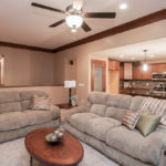 Great room and kitchen of Allison model features 11' ceilings, and corner fireplace