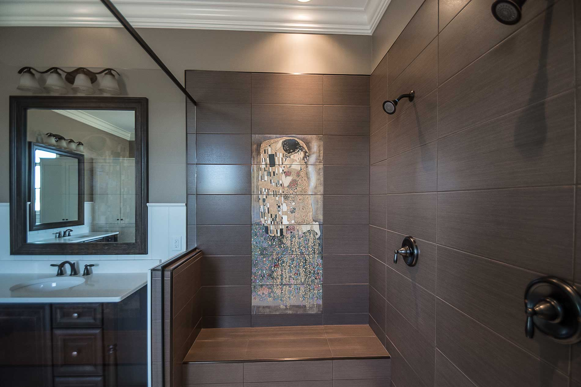 Custom tiled shower with bench and dual shower heads