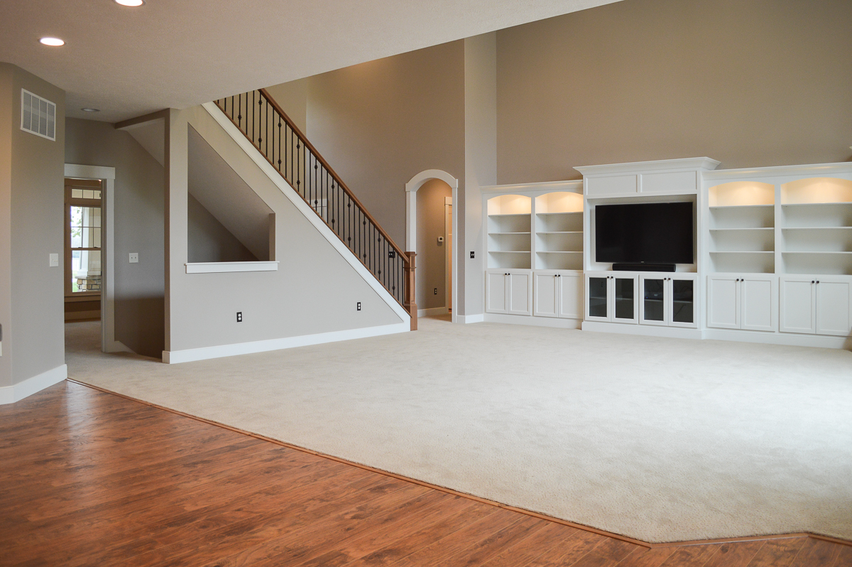 Great room of Berkshire model features wall-to-wall built ins