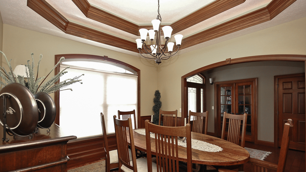 This Glendale dining room features a double treyed ceiling and stained wainscotting