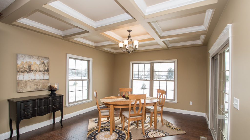 The breakfast nook in this Excalibur model features coffered ceilings