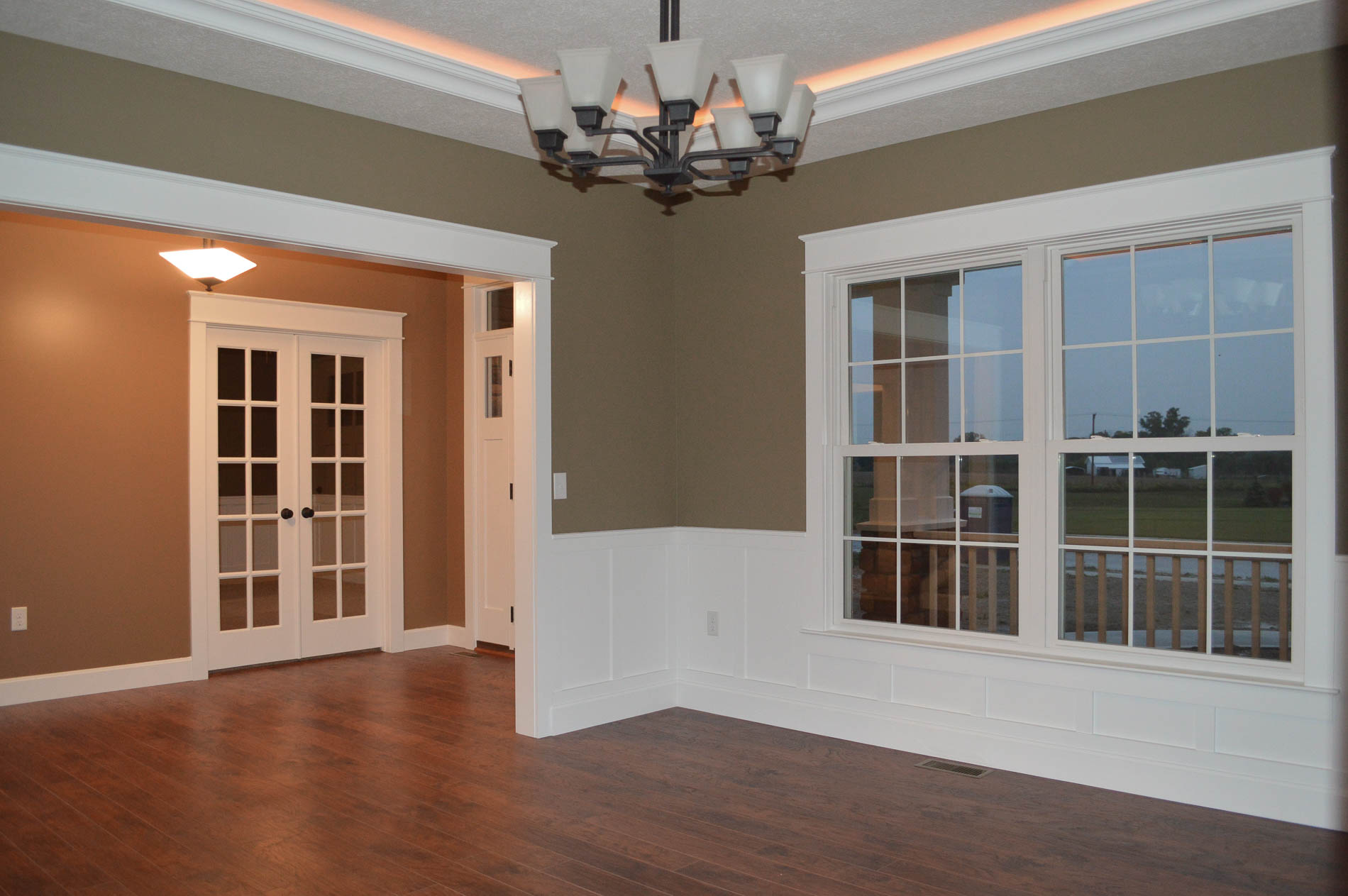 Dining room with North Park light fixture, trey ceiling and wainscot trim